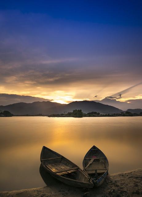 rowboats on serene lake