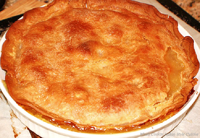 this is a pie made with fresh pineapple and in a homemade flaky crust