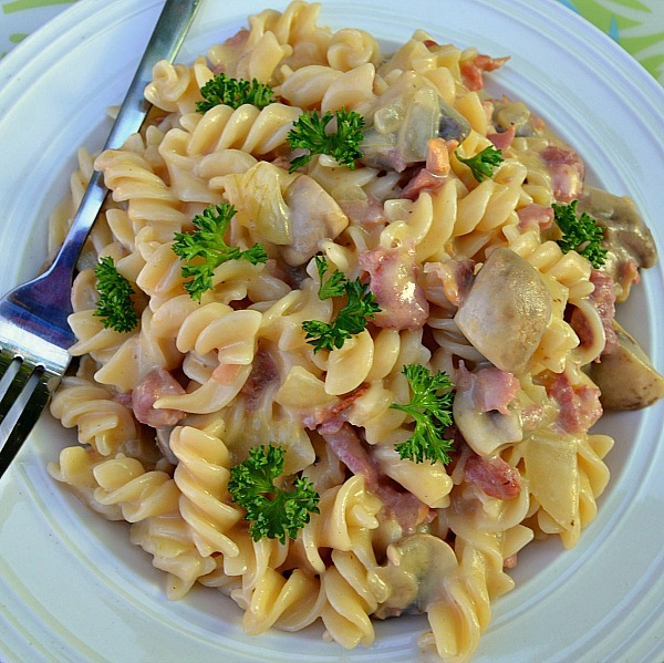 Bacon and Mushroom Pasta in a delicate, light sauce ~ This dish is ready in under 20 minutes and enough for 6 full servings