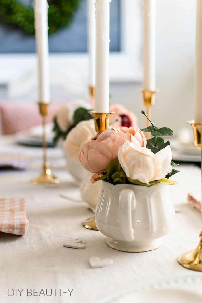 brass candlesticks, pink peonies and vintage ironstone