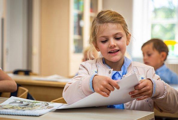 Crown Princess Victoria is wearing Baum und Pferdgarten skirt and blouse. Princess Estelle on the first school day