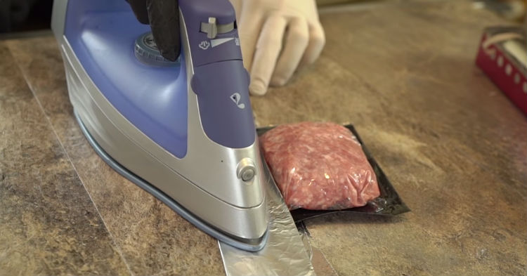 He Places Tin Foil On Top Of Ground Meat Then He Presses A Hot Iron Against It The Reason