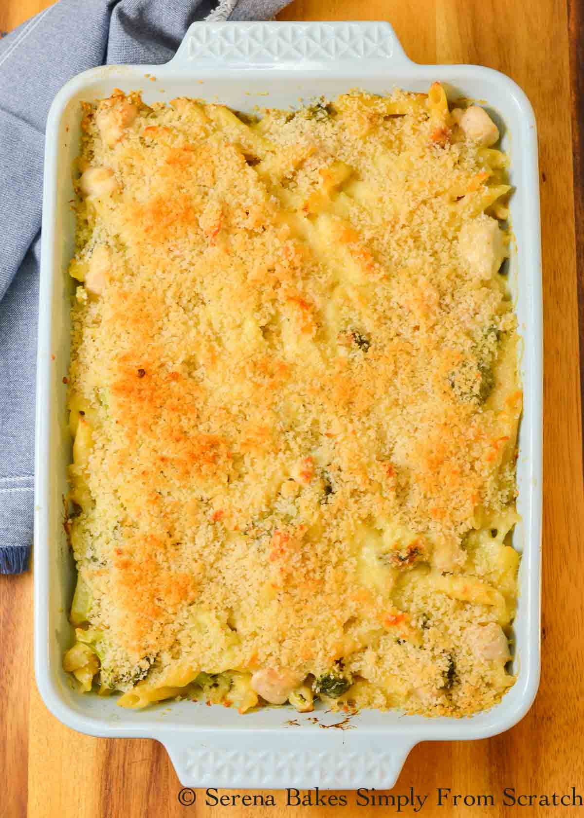 Chicken Broccoli Casserole in a white cheese sauce covered with panko bread crumbs in a light blue casserole dish.