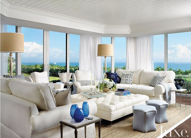 beach house with windows all walls design white tufted ottoman blue stools