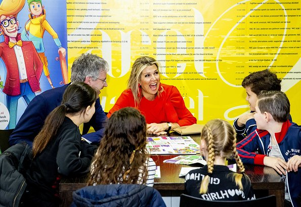 Queen Maxima wore a red top by Natan, and a Natan red wool coat at The Money Wise Platform