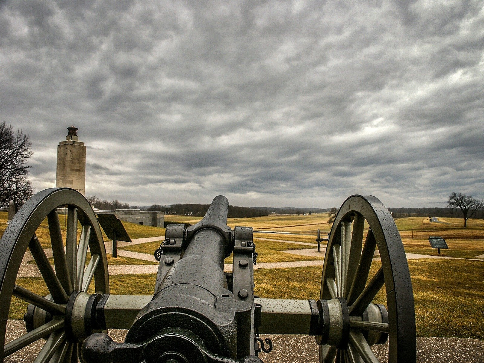 a civil war cannon is about to be shot over an empty field to illustrate war movies that make history come alive