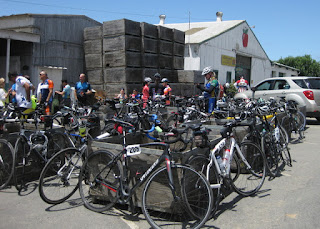 Cyclists, bicycles, and apple bins at Gizdich Ranch