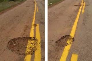 Empresa pinta faixa de sinalização em cima de buracos na rodovia que liga a BA-148