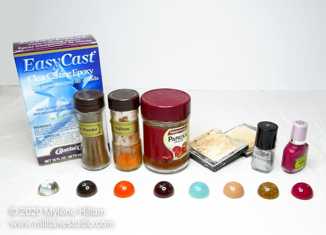 EasyCast resin package alongside a row of spice bottles and beauty products in front of a domed piece of resin coloured with that colourant.