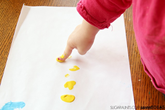 Farm themed math addition activity with baby chick fingerprint art