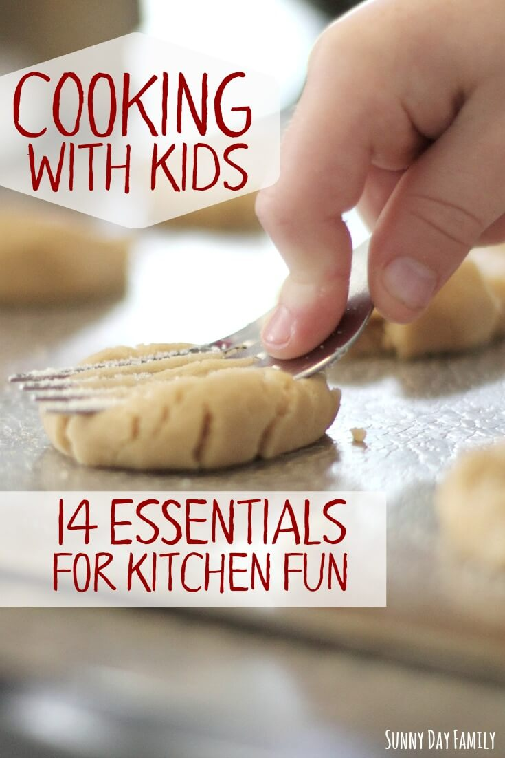 Cooking with kids? Make sure you have these 14 essential kitchen tools and accessories to make cooking fun! Includes fun kids cooking accessories and cookbooks for kids.