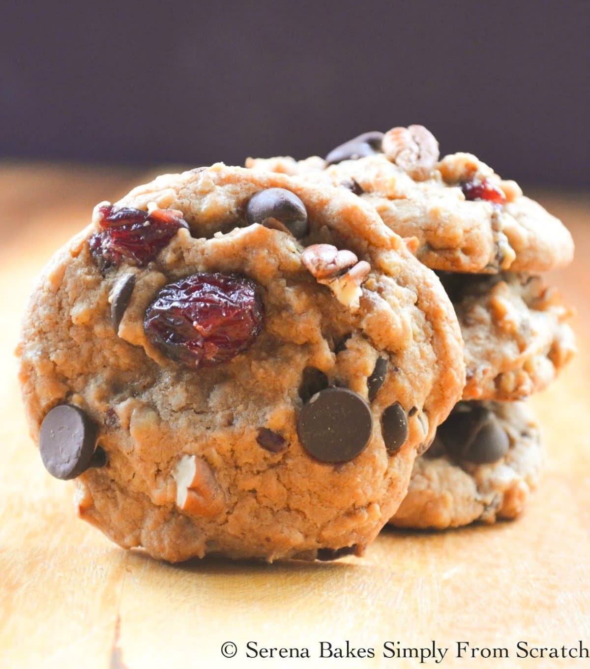 Caramel Chocolate Cranberry Treasure Cookies are a Christmas time favorite! Soft, chewy and delicious with graham cracker crumbs, coconut, dark chocolate, and dried cranberries from Serena Bakes Simply From Scratch.
