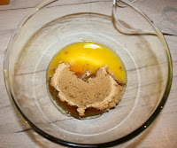 Glass bowl containing egg, melted butter and sugar