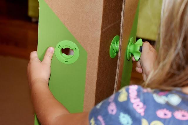 preschooler screwing together