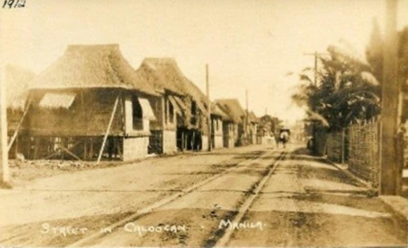 Street scene in rural Caloocan being traversed by tranvia tracks