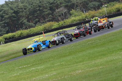 Daniel French leading the pack round Corum corner at Snetterton Circuit in race two of the 2019 Caterham 270r championship.