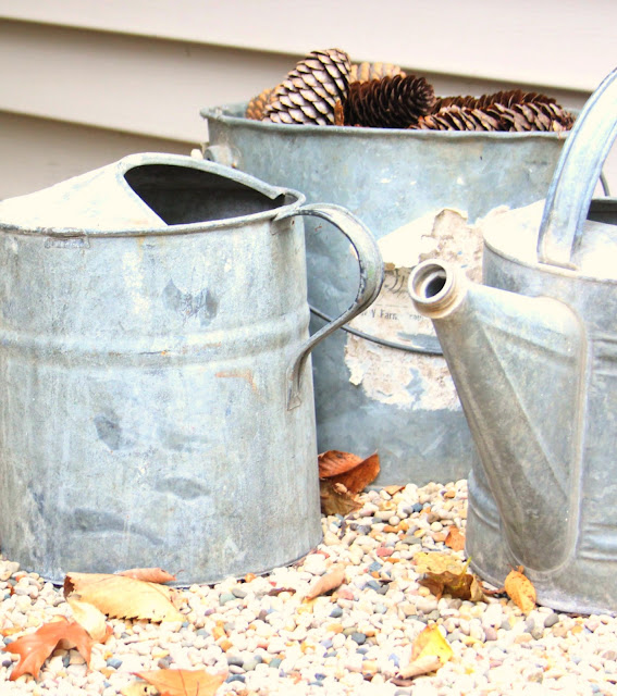 Galvanized buckets and pinecones in fall by Hello Lovely Studio