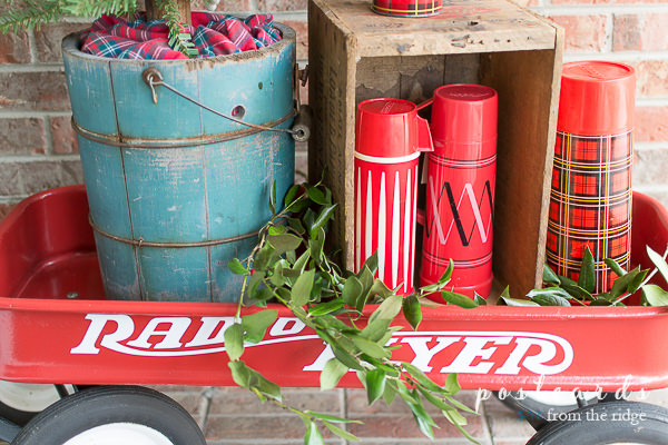 red wagon with old wooden bucket and vintage thermoses