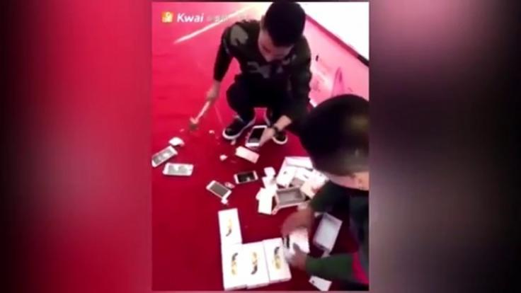 Arrogant Shop video: man buys all iphones in stock, smashes them to hit back