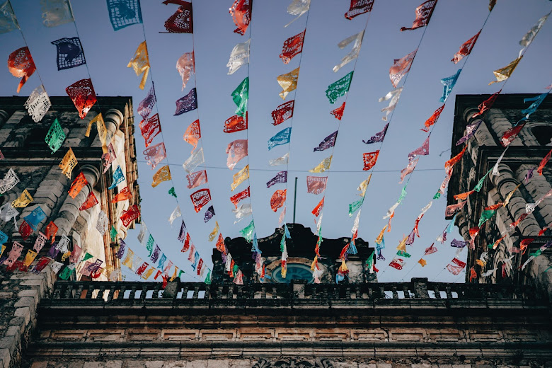 low angle photo of temple with latin american flags