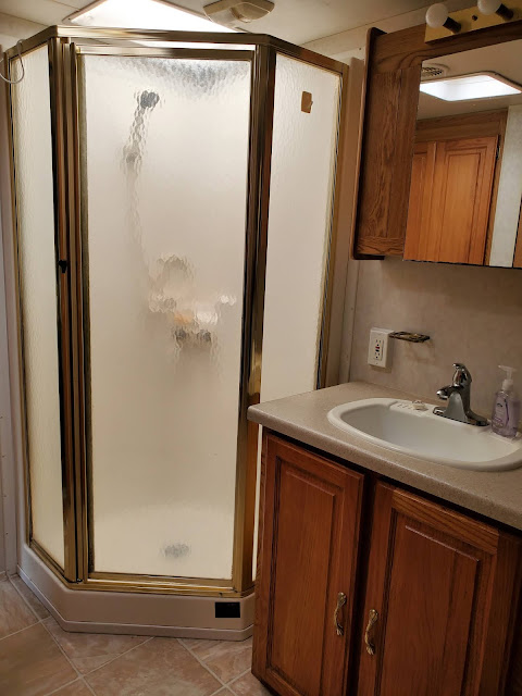 The John Wayne RV accomadation is able to separate from the living room and the bedroom.  The toilet is through a separate door to the left of the shower.