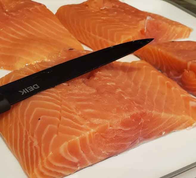raw salmon and Deik knife in the photo