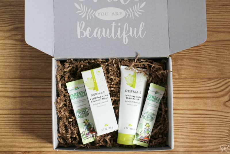 a box of Derma E skincare products