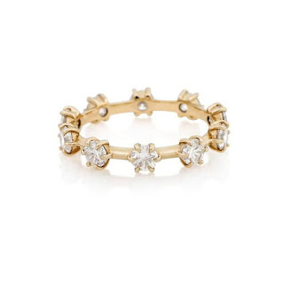 Be prepared to fall in love with the Kismet Band, which features 1-carat total weight of round diamonds. set in 14-karat gold. This style maximises sparkle and provides a chic, contemporary update to the simple eternity band. I think this would make a really cool alternative to wedding ring band and looks so cool when stacked with other rings. UK Jewellery Blog - Jewellery Curated