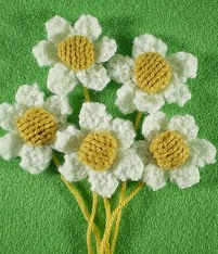 http://www.ravelry.com/patterns/library/springtime-wreath-daisies