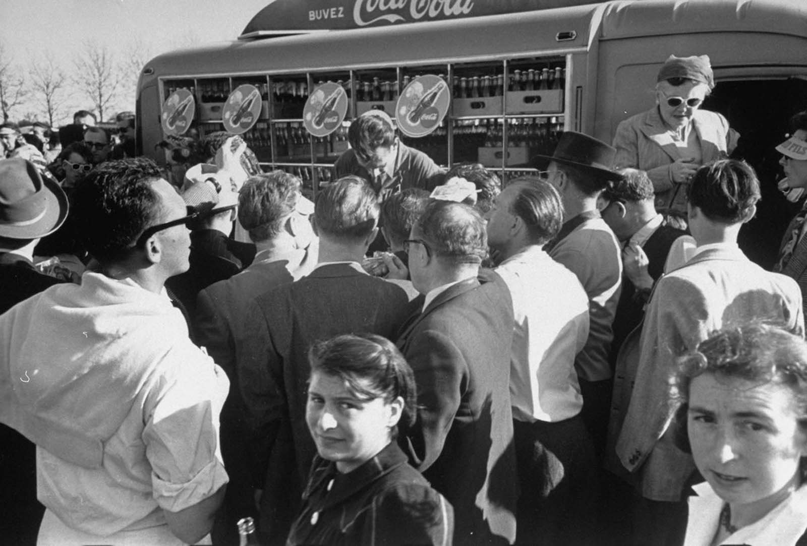 People buying Coca-Cola at an air exhibition.