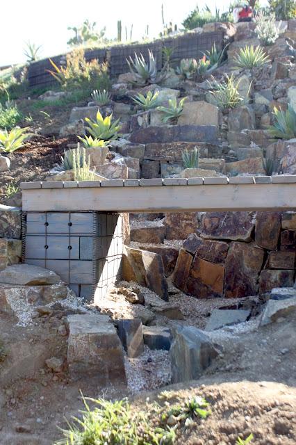 Footpath bridge sitting on gabion baskets