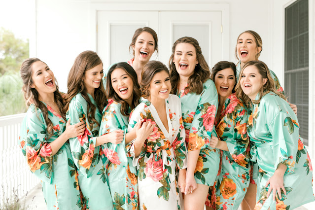 Bridal party laughing in robes