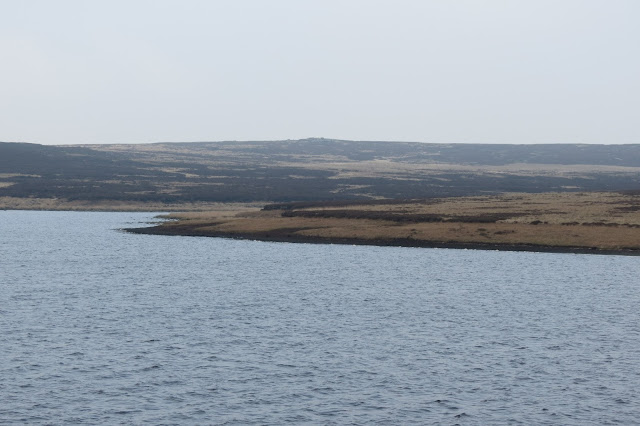 Looking out across the water, a slight prominence in the moorland beyond is the outline of the Little Holder Stones.