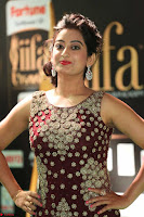 Tejaswini in Maroon Floor length Gown at IIFA Utsavam Awards 005.JPG
