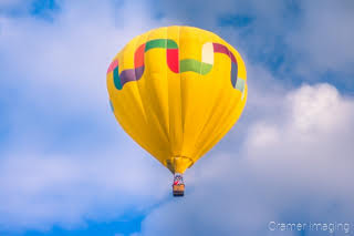 Cramer Imaging's fine art photograph of one yellow hot air balloon taking flight in Panguitch Utah with a cloudy morning sky