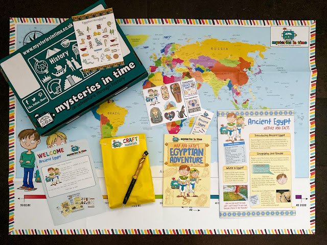 The contents of the Mysteries in Time Ancient Egypt Bumper size subscription box includes a map, booklet, magazine, postcard, stickers, pen and book