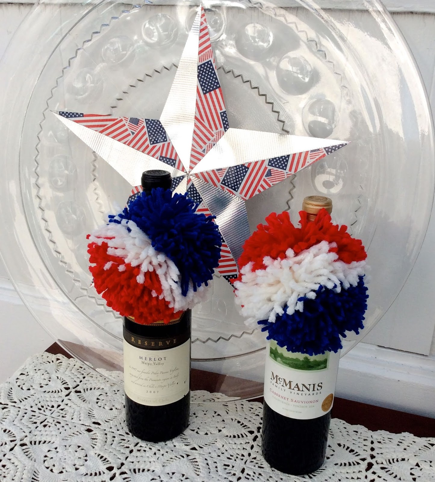 sweater surgery how to make red white and blue 4th of july pom poms to top of a bottle of. Black Bedroom Furniture Sets. Home Design Ideas