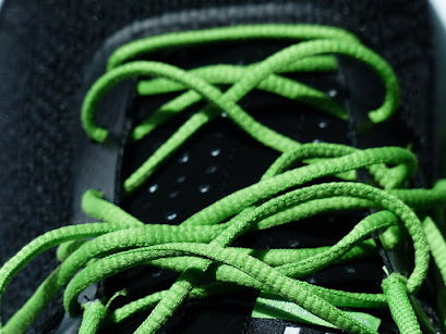 Picture of sneaker with green shoelaces
