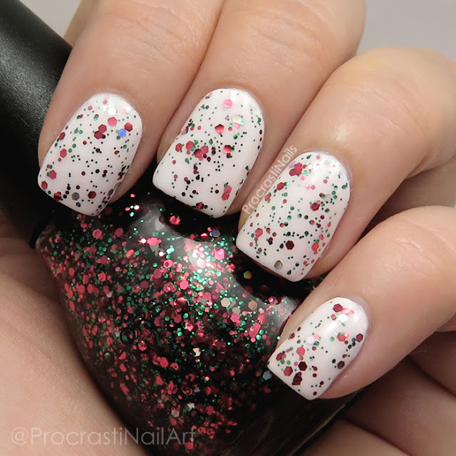 Swatch of Sinful Colors Holiday Rebel which is a topper with red, green and silver holo glitter