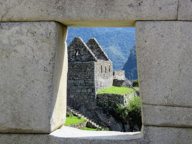 Machu Picchu pictures: Buildings of Machu Picchu viewed through a trapezoidal window