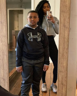 Averi Woodley clicking selfie with her son