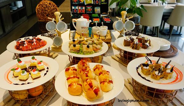 Seda Atria breastfast buffet - waiter - Bacolod blogger - Bacolod mommy blogger - bacon for breakfast - family travel - Iloilo City - Misto- afternoon snack - afternoon tea