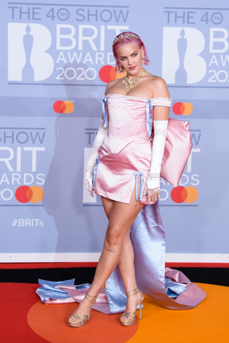 Anne-Marie impresses as she bares cleavage in dramatic pink mini dress at the 2020 BRIT Awards
