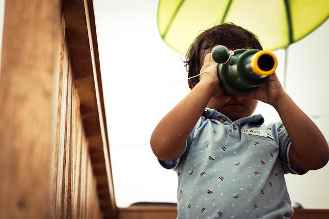 Child using a monoscope
