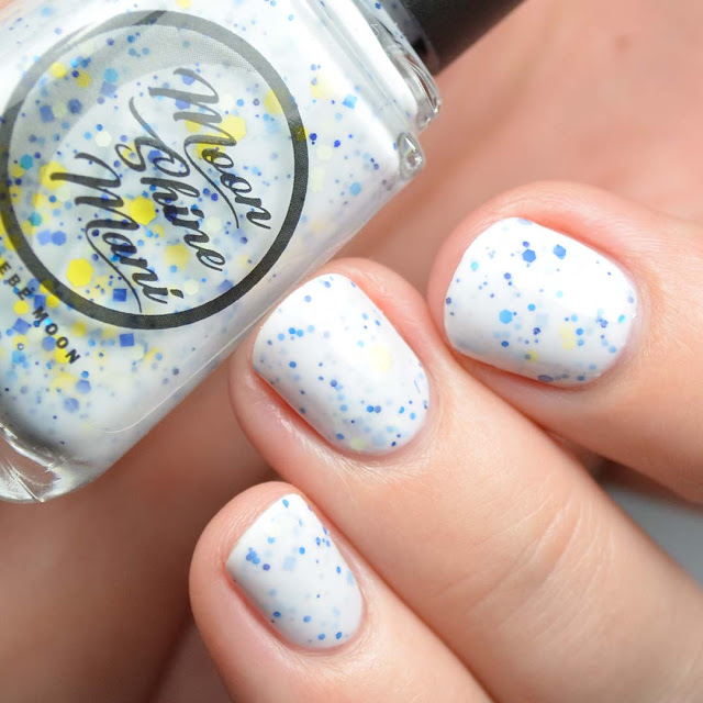 white crelly nail polish with blue and yellow glitter