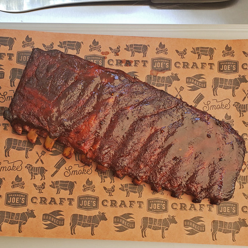 Competition style pork spare ribs from a Kamado grill featuring Cheshire Heritage Pork ribs
