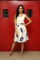 Actress Ritu Varma Stills in White Floral Short Dress at Kesava Movie Success Meet .COM 0144.JPG