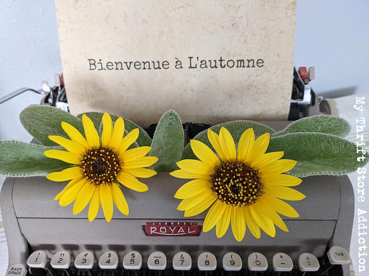 vintage typewriter with fresh flowers