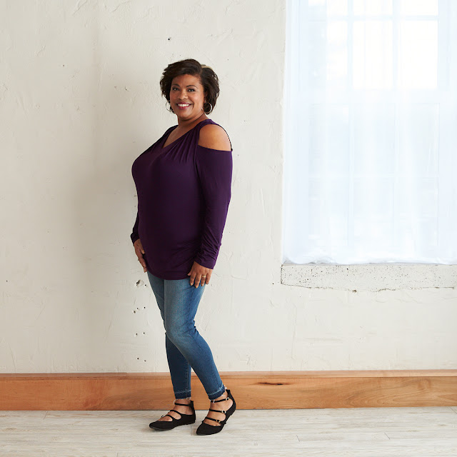 woman wearing a purple cold shoulder top