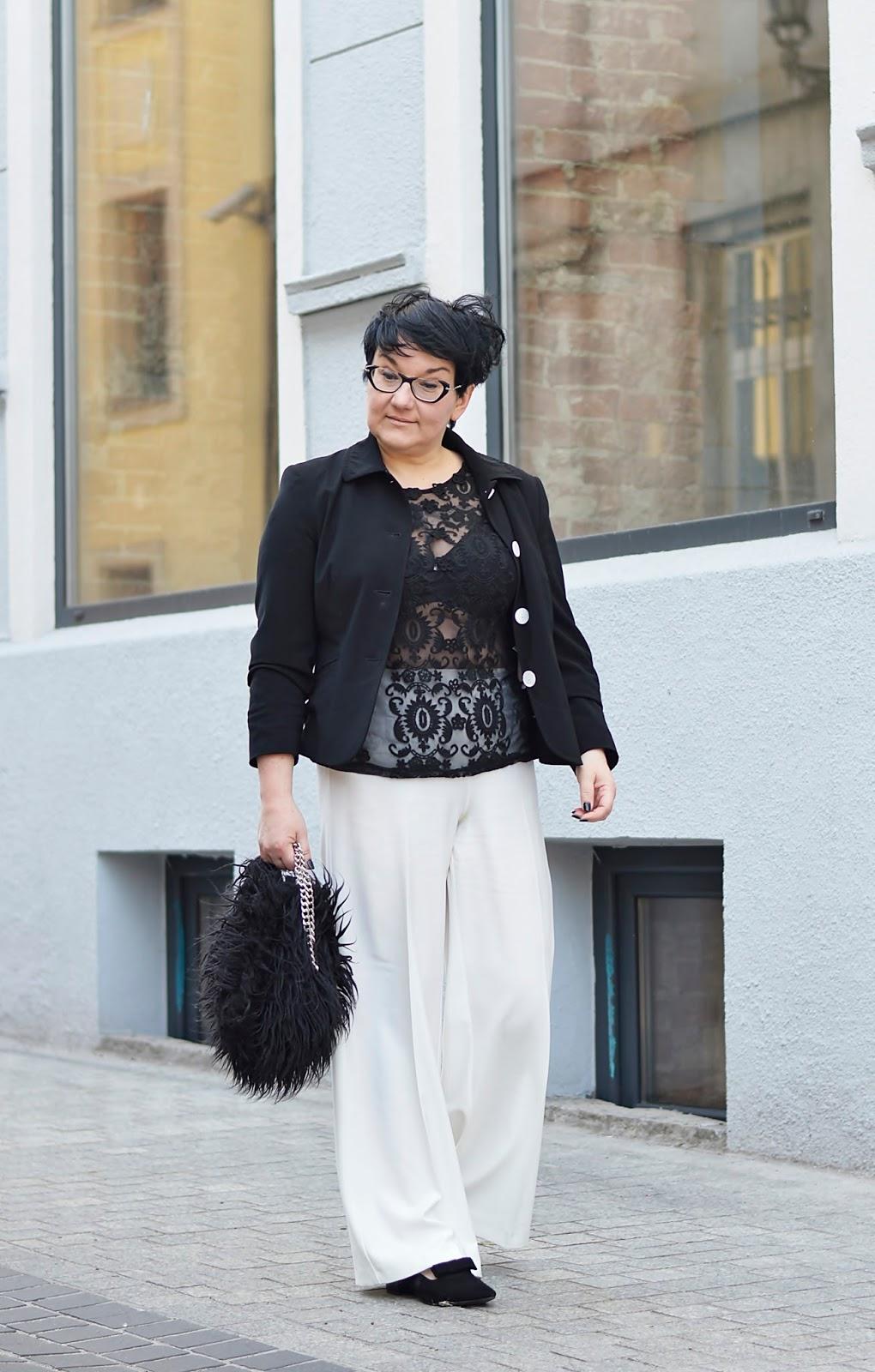 Black and white stylization, white pants, balck jacket, fur bag